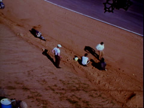 motorcycle race along hilly straightaway stretch at riverside international raceway in southern california / rider wearing blue riding leathers with... - 1970年点の映像素材/bロール