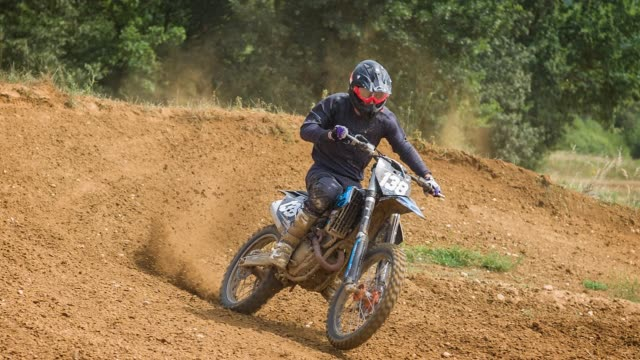 motorcycle racing on off road motor racing track, slow motion - off road racing stock videos & royalty-free footage