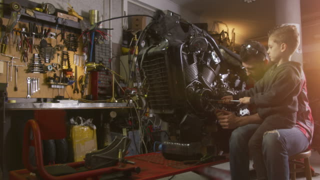 motorcycle repair shop - garage video stock e b–roll