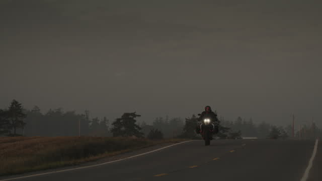 motorcycle rider on remote road at dusk / coupeville, washington, united states - approaching stock videos & royalty-free footage
