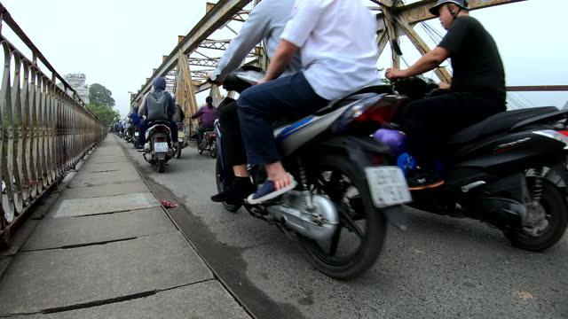 motorcycle riders commuting to work long bien bridge - bridge built structure stock videos & royalty-free footage