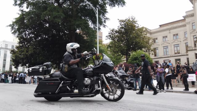 motorcycle riders rev their engines as they pass through the streets in front of the georgia state capitol building during a juneteenth event... - 1865 stock videos & royalty-free footage
