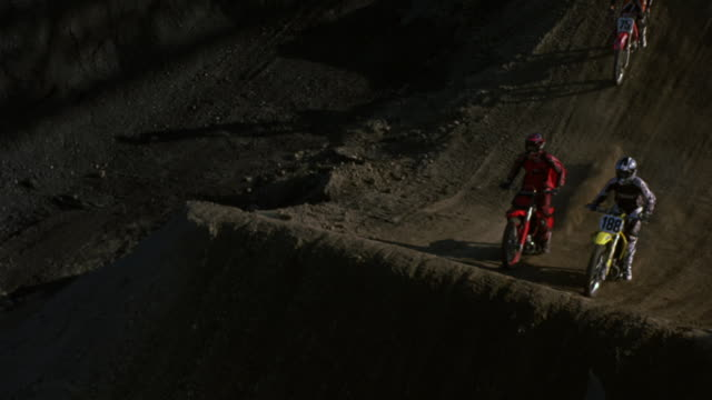 Motorcycle riders riding on a course.