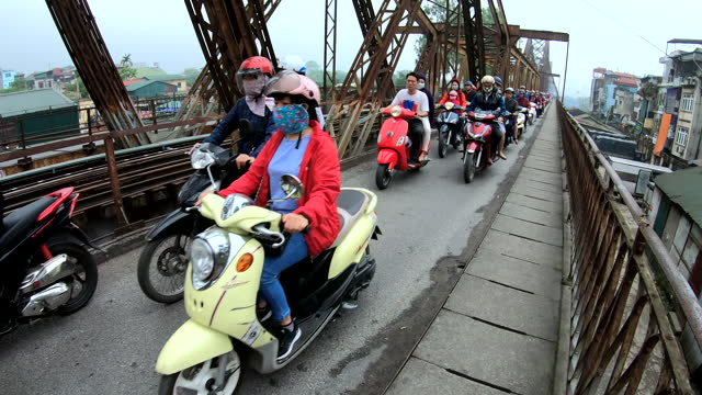 motorcycle riders wearing pollution protective masks hanoi vietnam - bridge built structure stock videos & royalty-free footage