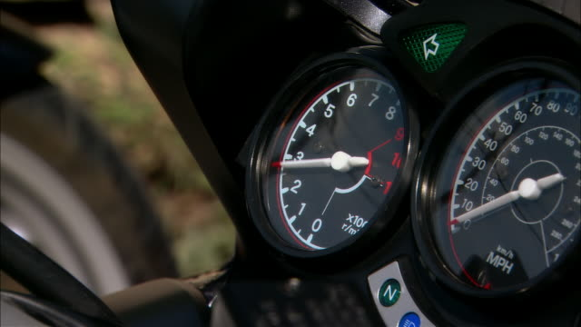 cu motorcycle speedometer/ zo man revving engine/ fresno county, california - motorbike stock videos & royalty-free footage