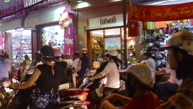 motorcycle traffic in ho chi minh city, vietnam - ベトナム点の映像素材/bロール