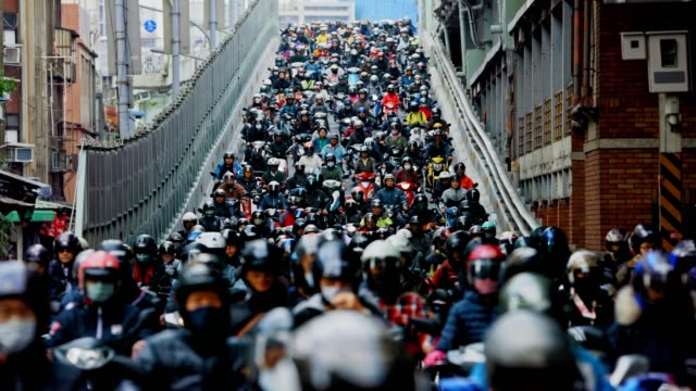 motorcycle waterfall, crowed of people are riding scooters in taipei - population explosion stock videos & royalty-free footage