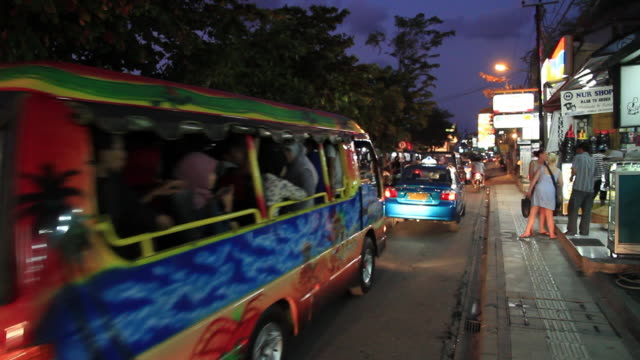 ws motorcycles and cars moving on streets / kuta, bali,indonesia - bali stock videos & royalty-free footage