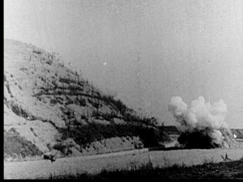 1925 b/w la ws motorcycles driving off cliff and exploding on impact / los angeles county, california, usa - klippe stock-videos und b-roll-filmmaterial