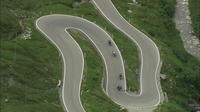 aerial zo motorcycles on hairpins bends, graubunden, switzerland - zigzag stock videos & royalty-free footage