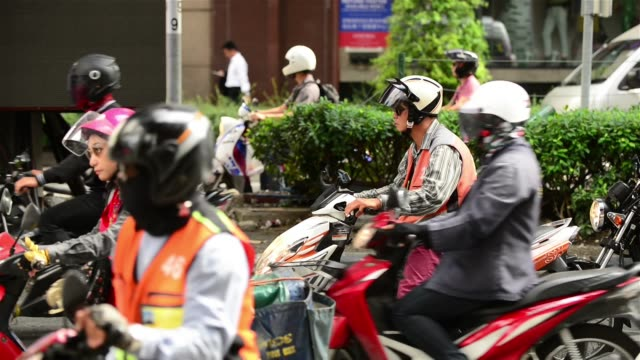 motorcycles stopping at traffic jam on chidlom intersection - bangkok stock videos & royalty-free footage