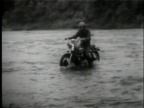 1958 ts motorcyclist driving through shallow river during 500-mile all-terrain race / lansing, michigan, united states - lansing stock videos & royalty-free footage