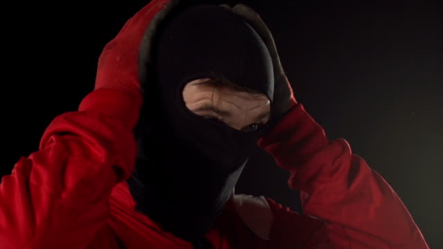 Motorcyclist / Formula One Driver putting Balaclava on