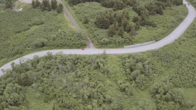 UHD 4K AERIAL: A motorcyclist out for a ride on a country highway