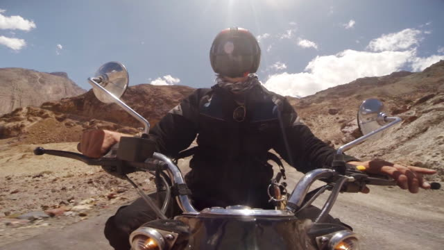 motorcyclist riding a classic bike, himalayas, india - motorbike stock videos & royalty-free footage