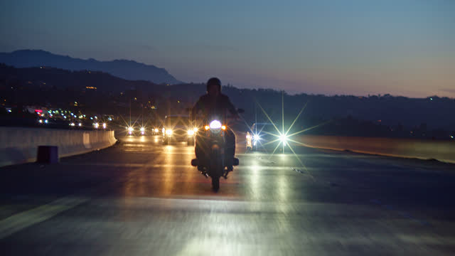 motorcyclist riding down freeway at night - motorbike stock videos & royalty-free footage