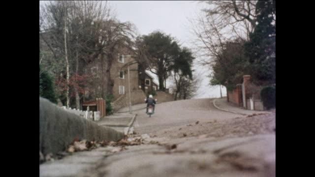 MONTAGE Motorcyclist riding down street / United Kingdom