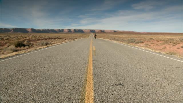 a motorcyclist speeds along highway 261 in utah. - biker stock videos & royalty-free footage