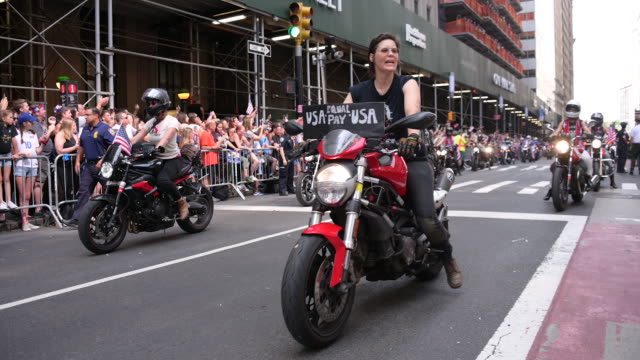 motorcyclists promoting equal pay at the us women's national soccer team victory parade and city hall ceremony on july 10 2019 in new york city - uguaglianza video stock e b–roll