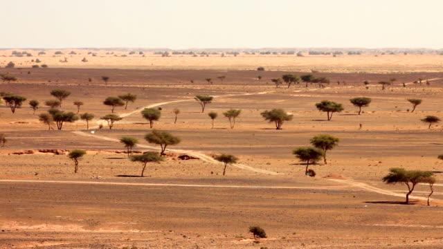 Motorcyle, Erg-Chigaga sand dunes. Sahara Desert, Mhamid, Morocco