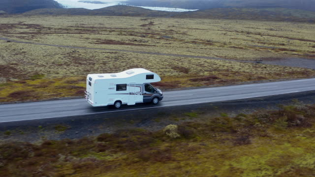 motorhome driving on the streets - camper van stock videos & royalty-free footage