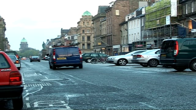 councils making money out of parking fines scotland edinburgh ext roundabout in george street traffic along george street back view man checking... - parking ticket stock videos & royalty-free footage