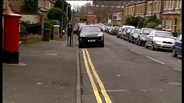 stockvideo's en b-roll-footage met double yellow lines removed in windsor; car parked in space next to double yellow lines pull out low angle shot of car parked on double yellow lines - itv weekend evening news