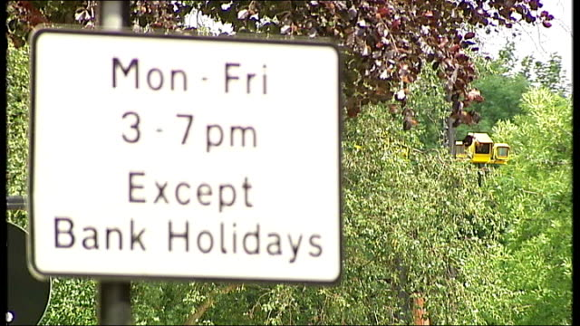 stockvideo's en b-roll-footage met motorists complain about confusing signs england london kentish town ext traffic signs on grafton road restricting the times that traffic can travel... - kentish town