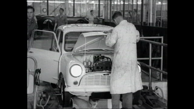 motoring oldest unrestored mini sells for thirty five thousand pounds bsp011096022 birmingham longbridge various of mini cars being produced on... - longbridge stock videos & royalty-free footage