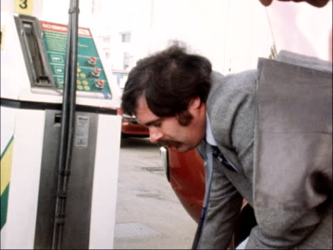 petrol prices rise ENGLAND EXT Poster informing motorists of fuel rations Man filling plastic container/can with petrol as interviewed SOT You need...