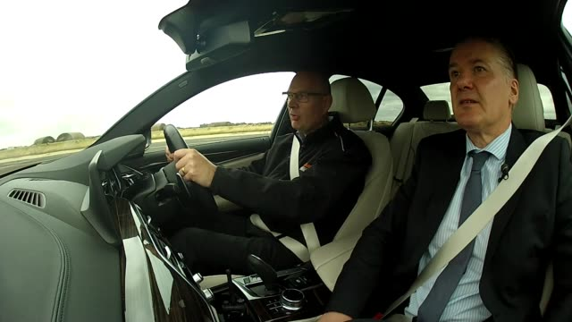 road safety experts worried drivers overestimating socalled 'selfdriving' cars england reporter in car ext car along using cruise control int car... - driverless car stock videos & royalty-free footage