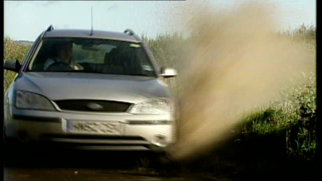 woman fails driving test after splashing pedestrian at bus stop car along on country road as drives through roadside puddle kelly reading highway... - driving test stock videos and b-roll footage