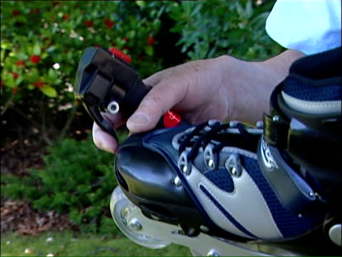 motorised rollerblades are health and safety risk; david morton interview sot - they're conventional skates but have engine bolted to back / black... - throttle stock videos & royalty-free footage