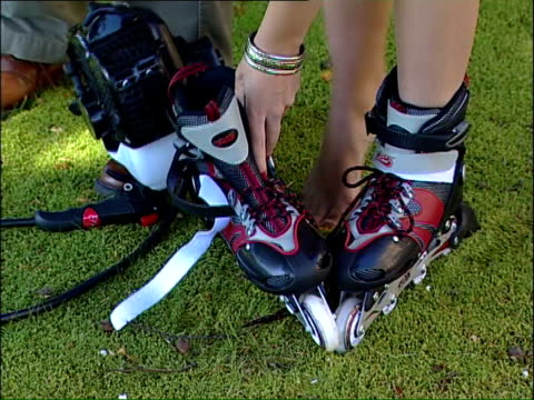 motorised rollerblades are health and safety risk england hampshire bournemouth ext rollerblade boot on display as new motorised rollerblade boot... - pair stock videos & royalty-free footage