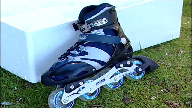 motorised rollerblades for sale on black market; england: london: ext 'powerblades' being taken from box and laid out on grass by david morton... - sporting footwear stock videos & royalty-free footage