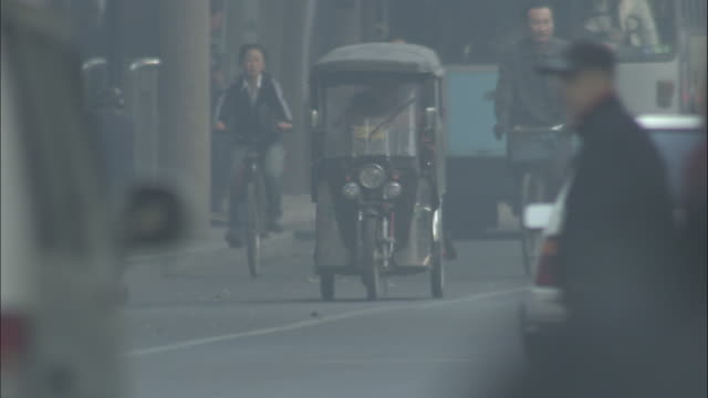 Motorised tricycle on streets of Beijing, China.