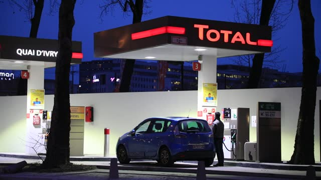 motorist fills up his tank at a total brand gas station on january 20, 2021 in paris, france. the multinational total announced monday an investment... - automobile industry stock videos & royalty-free footage