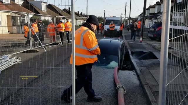 motorist had a lucky escape after his car fell into a huge sinkhole in essex following wild weather caused by storm ciara. homes were evacuated on a... - road accident stock videos & royalty-free footage