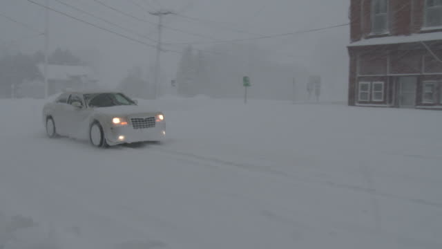 a motorist navigates very deep snow in adams new york during a heavy lake effect snowstorm - scott mcpartland stock videos & royalty-free footage