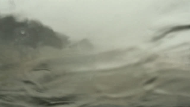 Motorist's point-of-view of driving into a storm surge during a hurricane.