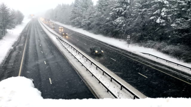 Motorists travel through a heavy snow shower on the M8 on January 16 2018 in Harthill Scotland Snow and sleet conditions are affecting large parts of...