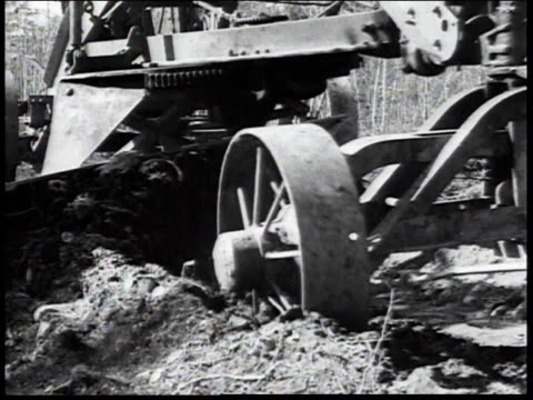 vidéos et rushes de 1936 montage motorized plow turning over soil in field / united states - civilian conservation corps