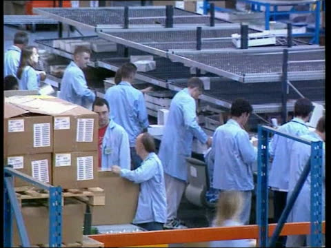 vídeos y material grabado en eventos de stock de motorola job cuts/brown comments on global slowdown; lib int tgvs packing production line in motorola mobile phone plant bv woman worker examining... - motorola
