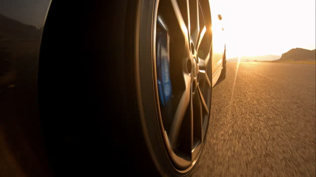 motorsport car racing, closeup view of spinning wheel and motor racing track reflection in car - accelerator pedal stock videos & royalty-free footage