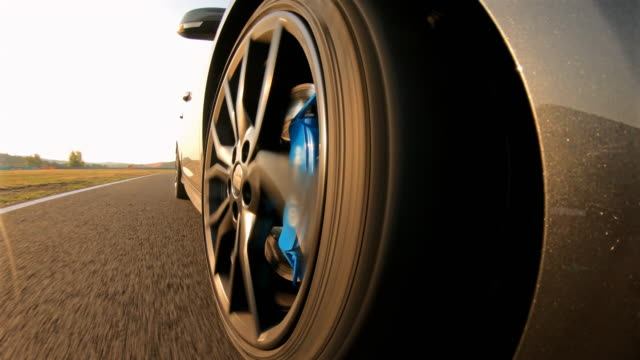 motorsport car racing, view of spinning wheel and motor racing track reflection in car - wheel stock videos & royalty-free footage