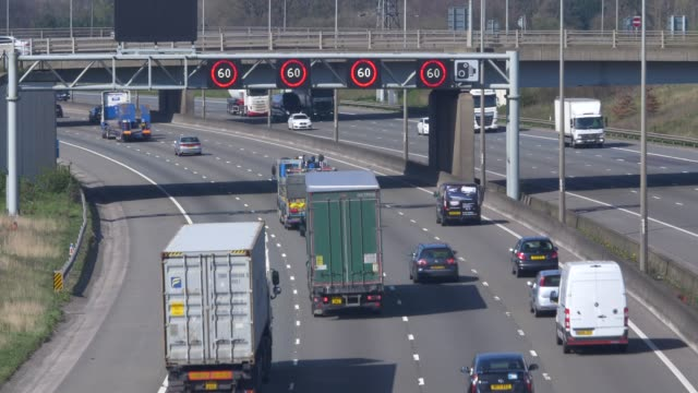 m1 motorway at junction 10 for luton airport - heavy goods vehicle stock videos & royalty-free footage