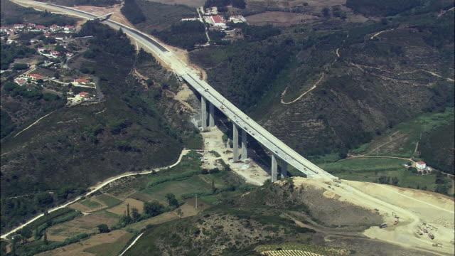 aerial ws zi pan motorway bridge under construction / cascais, lisbon, portugal - cascais stock videos and b-roll footage