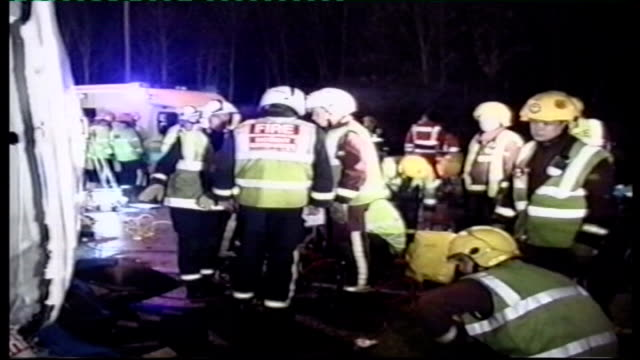 report from depot where safety checks are taking place file / tx london m4 / m25 interchange emergency service workers at scene of crash coach lying... - lying on side stock videos & royalty-free footage