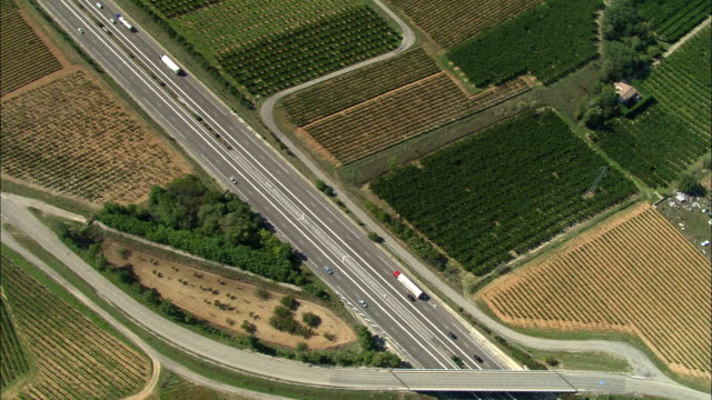 AERIAL, Motorway crossing green fields, Rhone-Alpes, France