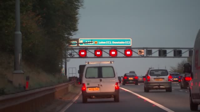 Motorway driving EXT Various Dusk and Night POVs from car as driving along motorway with speed restrictions overhead